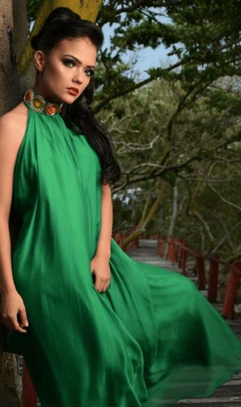 Mafe wearing green long dress