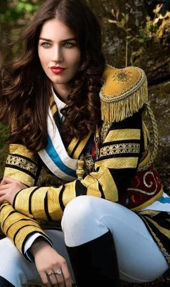 Betina wearing yellow uniform