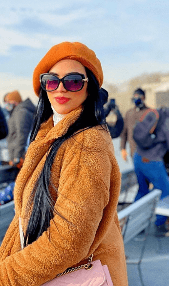 beige hat and coat with sunglasses