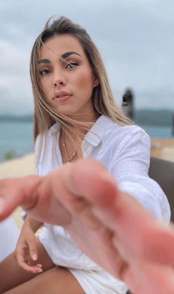 Hand reaching photo of Mila