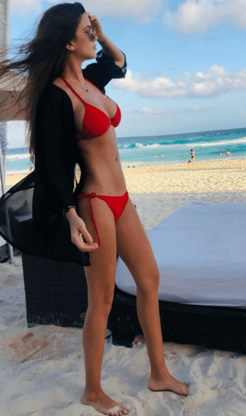 Pia wearing red swimsuit