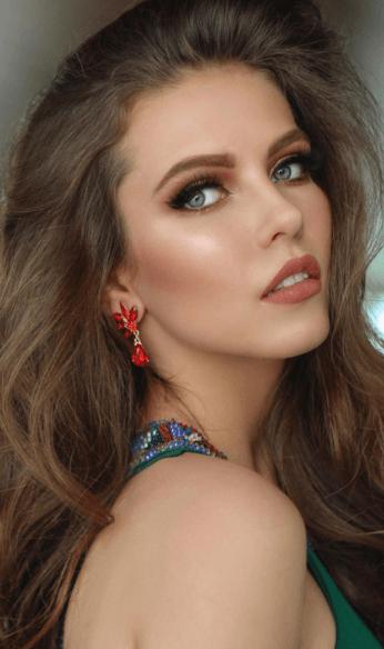 Thania wearing red earrings