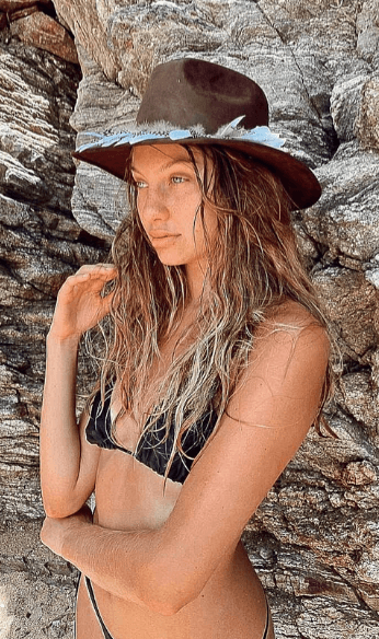 Cowgirl hat and black swimsuit