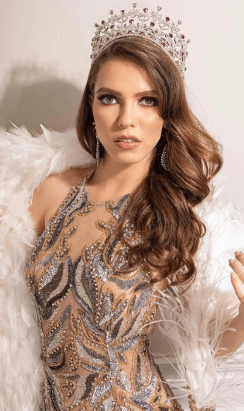 Thania wearing brown lace dress and white fur