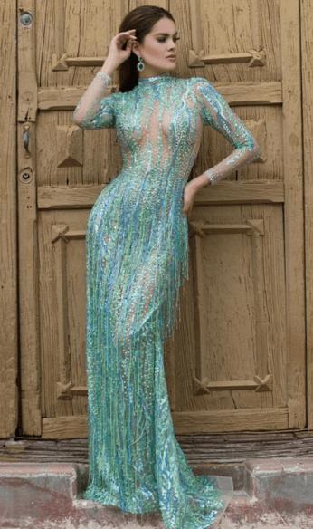 Paloma wearing turquoise dress