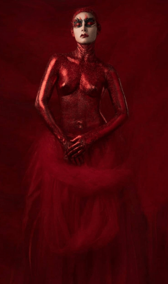 Sabrina covered in red
