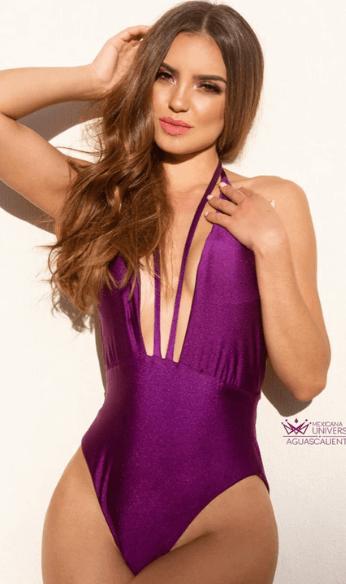 Viviana wearing purple colored swimsuit
