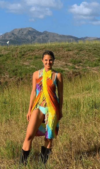Ana wearing colorful top
