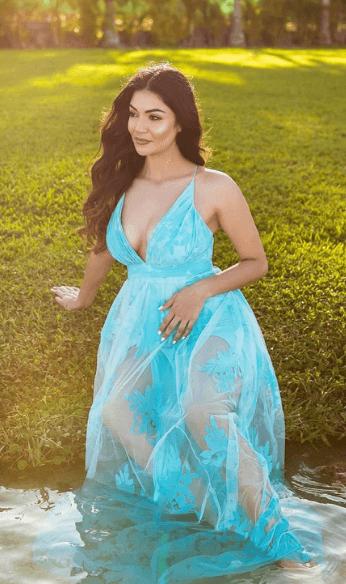 Brenda wearing turquoise dress