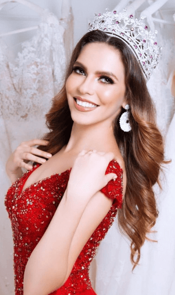 Thania in Red dress with crown