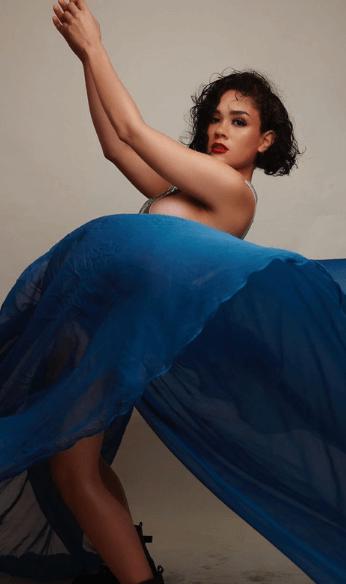 Maria wearing blue dress