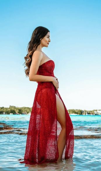 Brenda wearing red lace dress