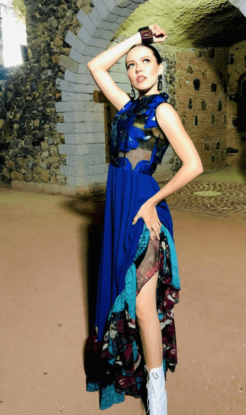 long blue dress with white heels