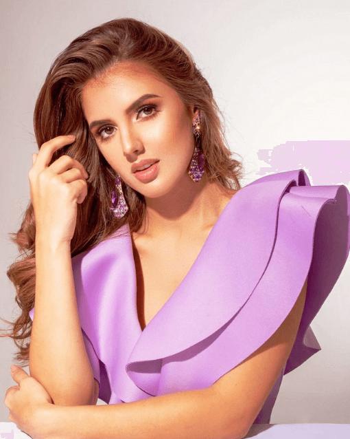 Ana wearing light purple top