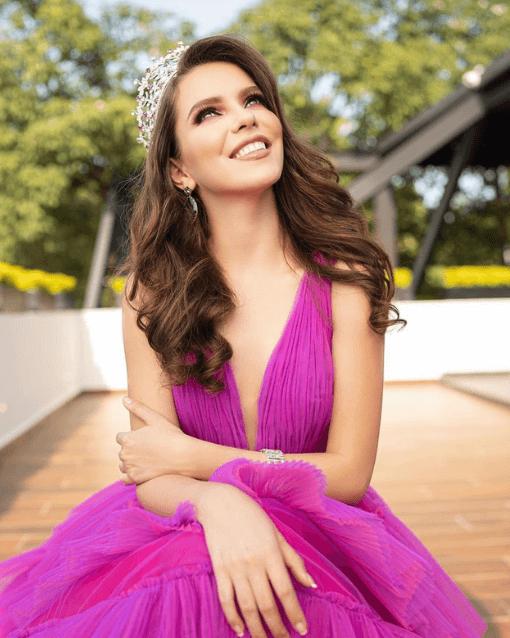 Thania wearing fluffy purple dress