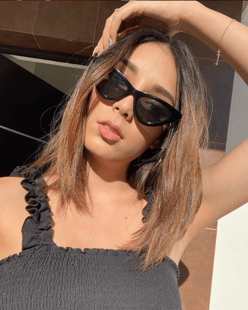 Black top and black sunglasses