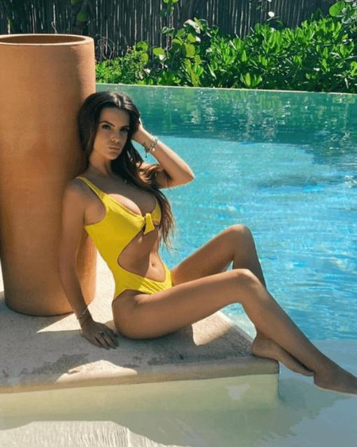 Pia wearing yellow swimsuit